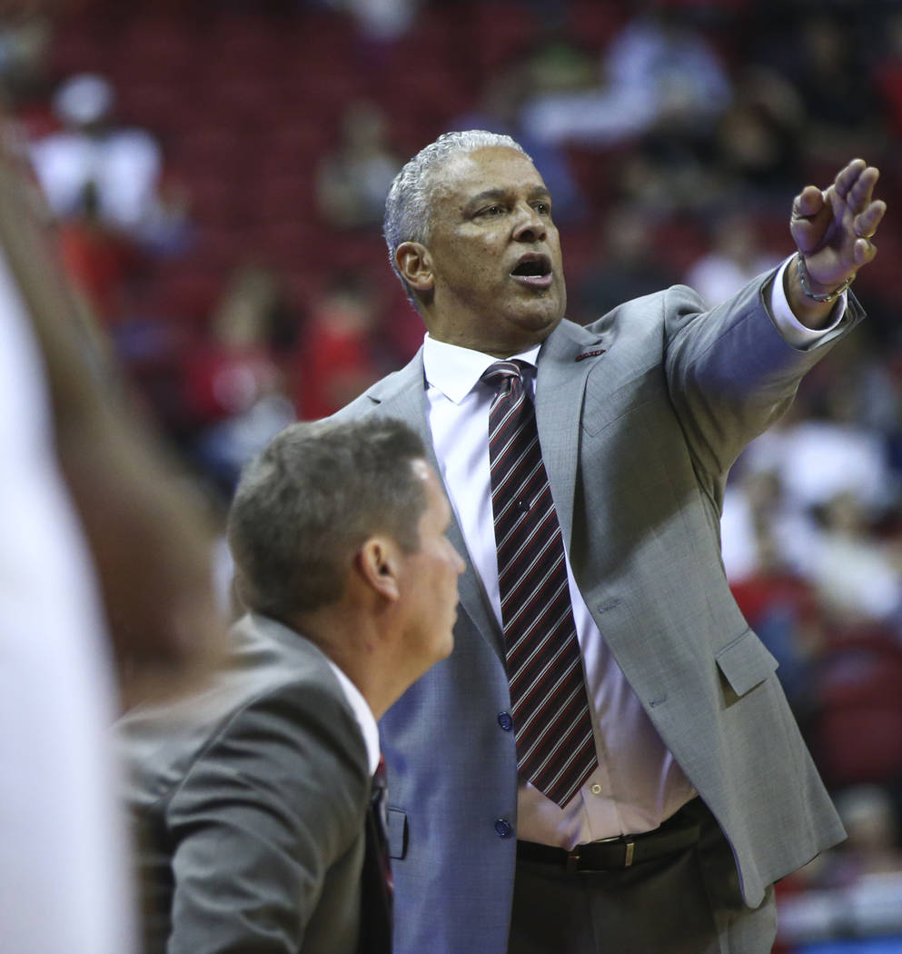UNLV head coach Marvin Menzies shouts to his players as they take on Florida A&M during their basketball game at the Thomas & Mack Center in Las Vegas on Saturday, Nov. 11, 2017. Chase Ste ...