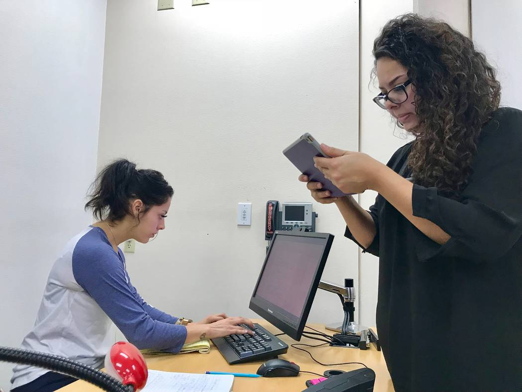 Karen Ortega, left, and Anneth Ortega, right, work on writing a piece they worked on with their journalism class. The class forms the staff of Coyote Student News, which recognized its fifth anniv ...