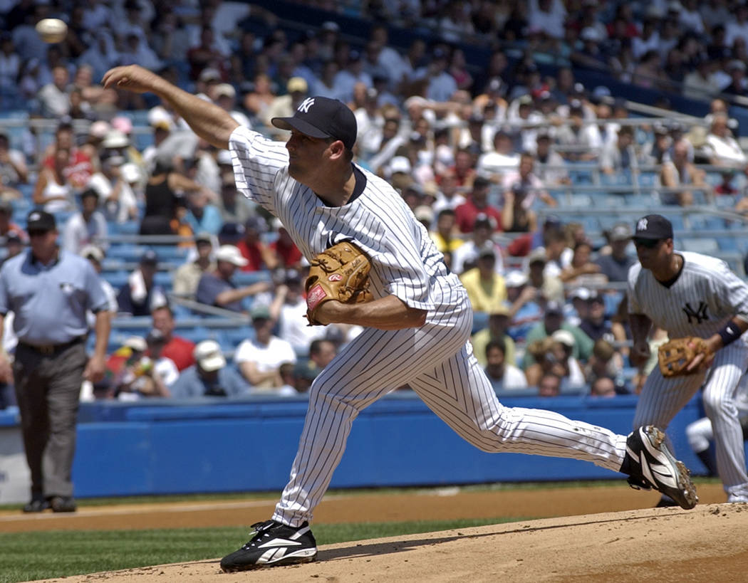 New York Yankees pitcher Cory Lidle delivers the ball to the Toronto Blue Jays in the first inning during of baseball action Thursday, Aug. 3, 2006 at Yankee Stadium in New York. (AP Photo/Bill Ko ...
