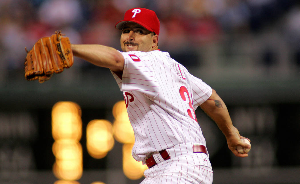 ** FILE ** Former Philadelphia Phillies pitcher Cory Lidle pitches during the 2006 baseball season. A small plane carrying New York Yankee Cory Lidle slammed into a 50-story skyscraper Wednesday,  ...