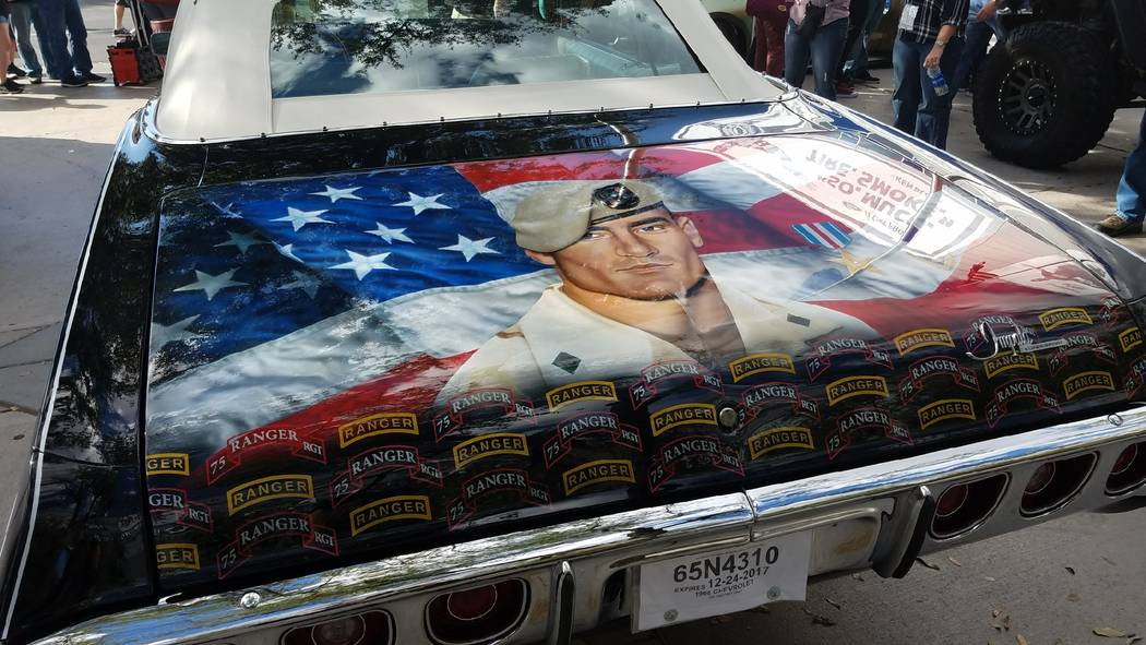 A Chevrolet Impala that belonged to Pat Tillman has been restored and airbrushed with a mural depicting his football career and military service. It was on display at the Specialty Equipment Marke ...