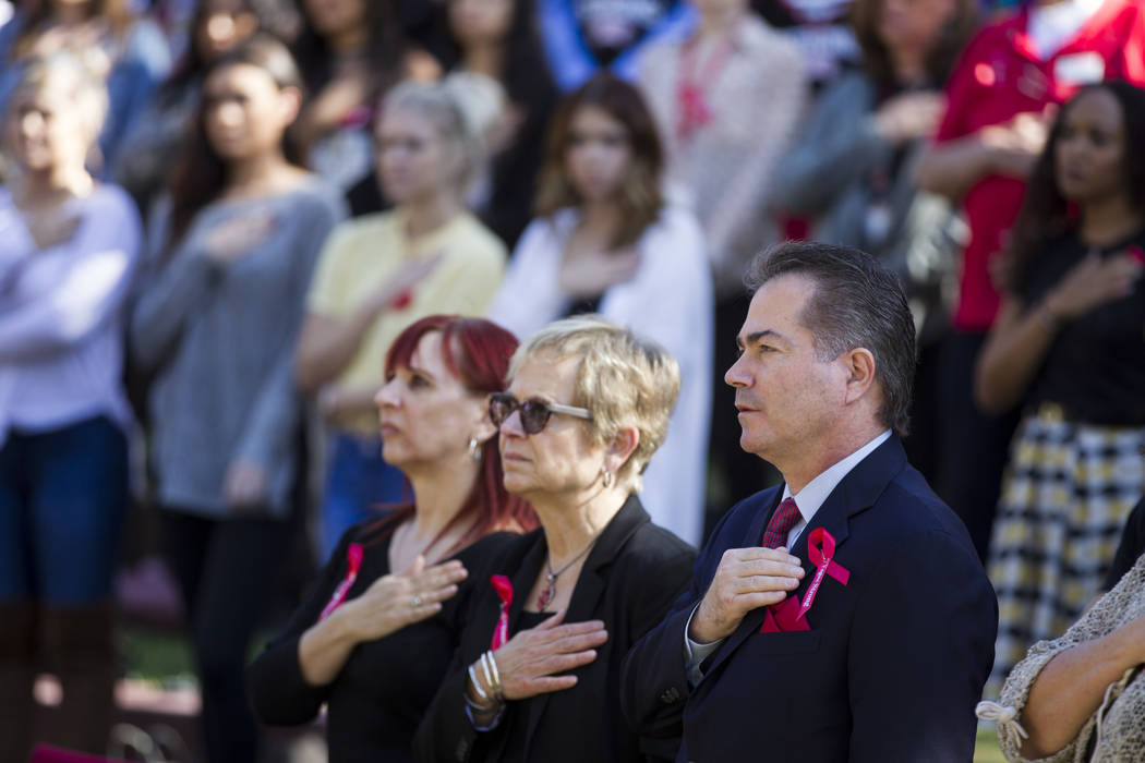 People including UNLV President Len Jessup, right, attend a remembrance ceremony for the mass shooting victims at UNLV in Las Vegas, Thursday, Nov. 2, 2017. Erik Verduzco Las Vegas Review-Journal  ...