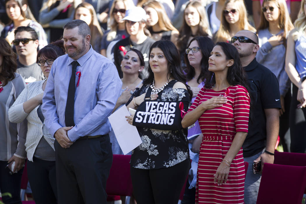 Karessa Royce, center, an UNLV student who was shot during the Route 91 Harvest Festival, stands with her parents Richard, left, and mother Monica, during a remembrance ceremony for the mass shoot ...