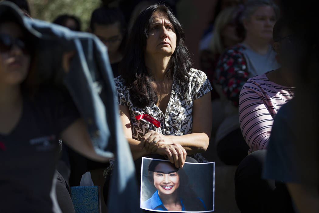 UNLV administrative assistant Sharon Goins, center, holds a picture of Michelle Vo, a friend of her daughter who died in the Route 91 Harvest Festival, during a remembrance ceremony for the mass s ...