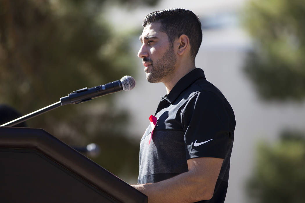 Nick Robone, a UNLV assistant hockey coach, was shot in the chest at the Route 91 Harvest Festival, speaks during a remembrance ceremony for the mass shooting victims at UNLV in Las Vegas, Thursda ...