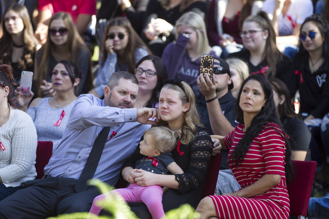 Listening to a speech by his daughter Karessa Royce, an UNLV student, Richard, from left, wipe tears of his daughter Ashlyn, with his niece Dessa Anderson and wife Monica, during a remembrance cer ...