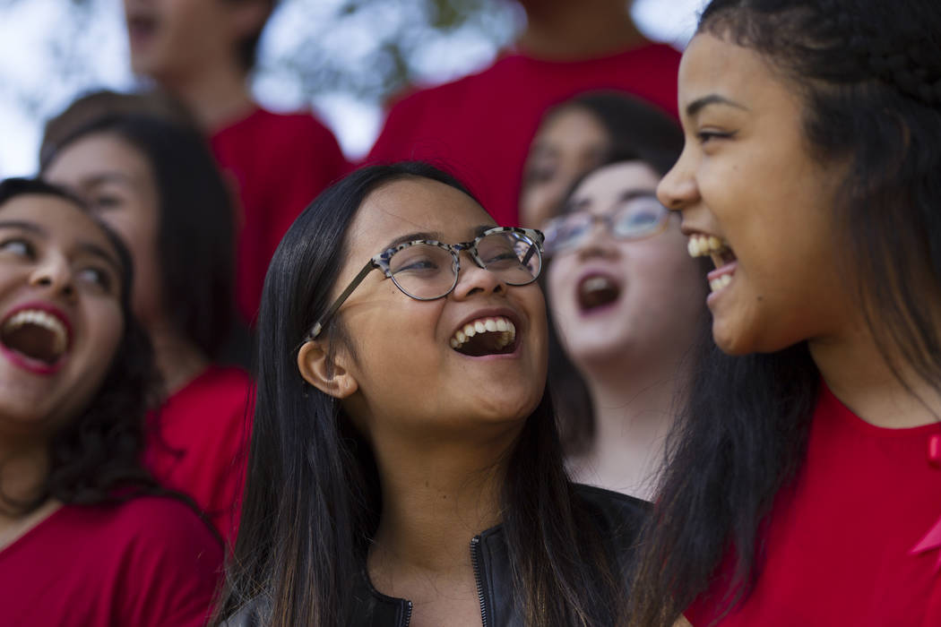 UNLV concert singers Alessandra Las, left, and Mina Fisher, right, perform during a remembrance ceremony for the mass shooting victims at UNLV in Las Vegas, Thursday, Nov. 2, 2017. Erik Verduzco L ...