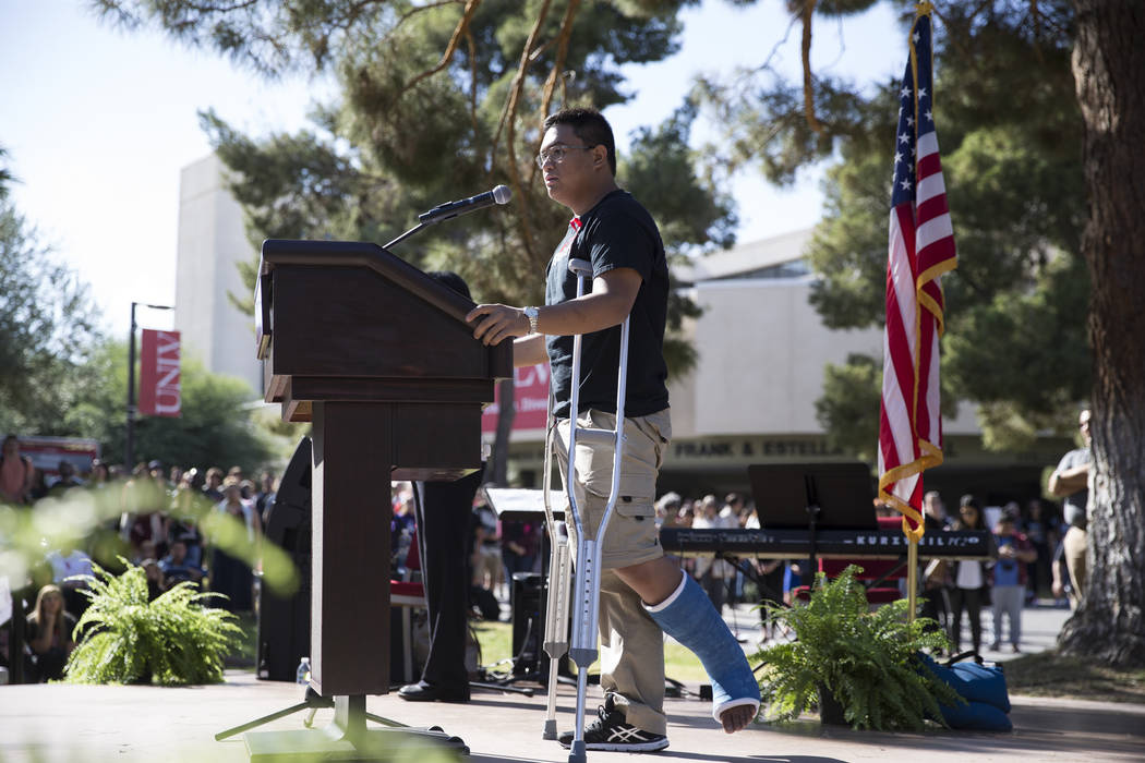 Joshua Abellera, a UNLV student, broke his leg escaping the Route 91 Harvest Festival grounds, speaks during a remembrance ceremony for the mass shooting victims at UNLV in Las Vegas, Thursday, No ...