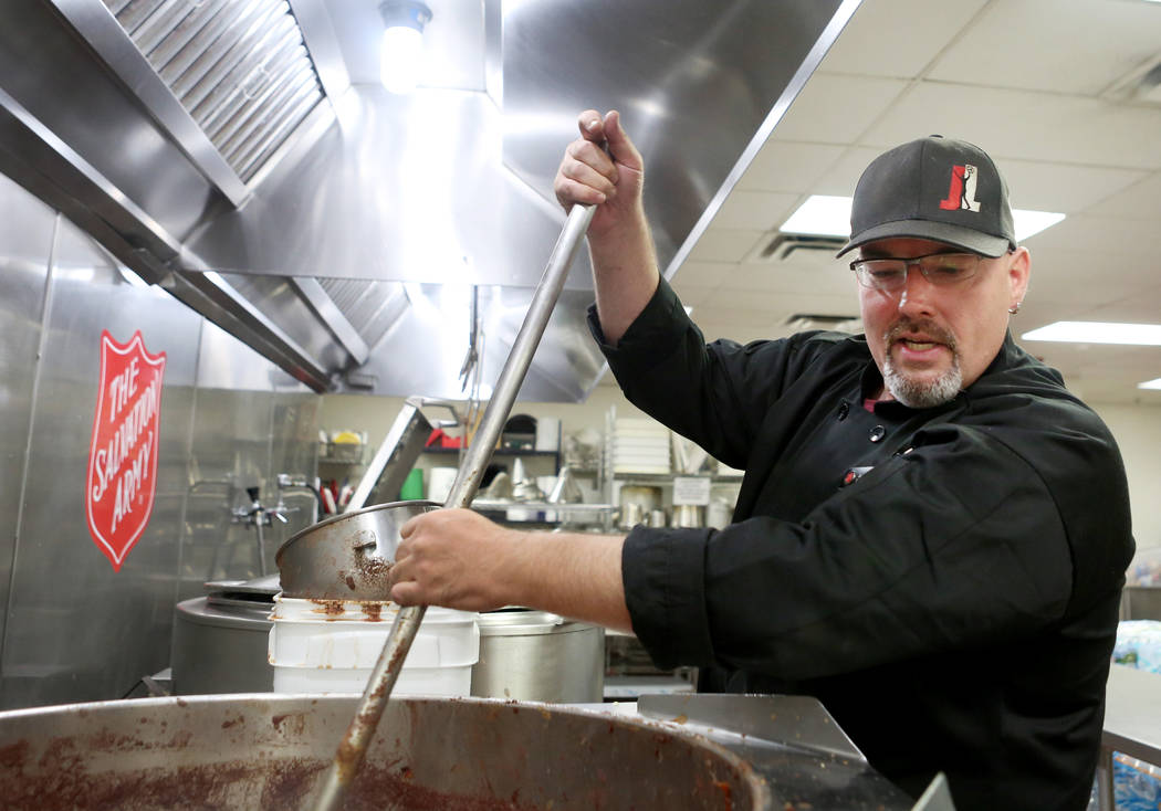 Executive chef at the Salvation Army Jeremy Wood stirs  black beans for their vegan meal option at the Salvation Army in Las Vegas, Wednesday, Nov. 15, 2017. Elizabeth Brumley Las Vegas Review-Jou ...