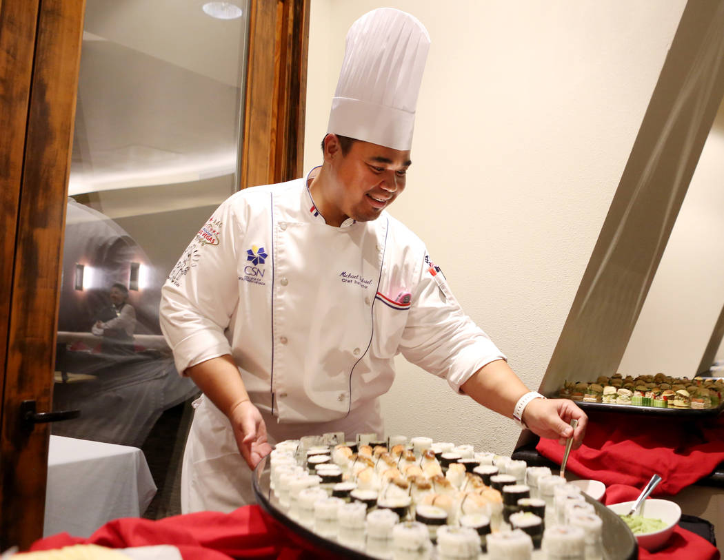 Chef instructor Michael Gabriel sets out sushi prepared by graduates of the Salvation Army Culinary Arts Program for the 44th graduation ceremony at the College of Southern Nevada in North Las Veg ...