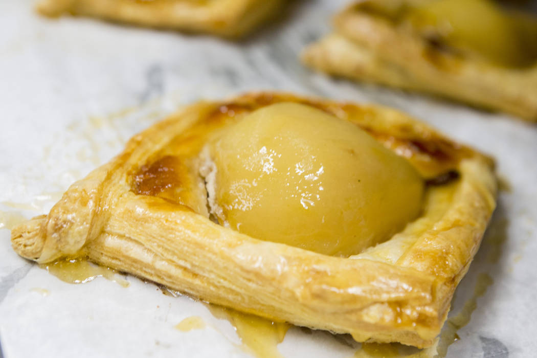 Poached Pear Tart prepared by graduates of the Salvation Army Culinary Arts Program for the 44th graduation ceremony at the College of Southern Nevada in North Las Vegas, Wednesday, Nov. 1, 2017.  ...