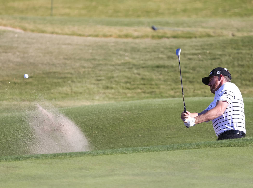 Jimmy Walker of Texas plays a shot from the bunker on the ninth hole during the first round of the Shriners Hospitals For Children Open at TPC at Summerlin in Las Vegas, Thursday, Nov. 2, 2017. Ri ...