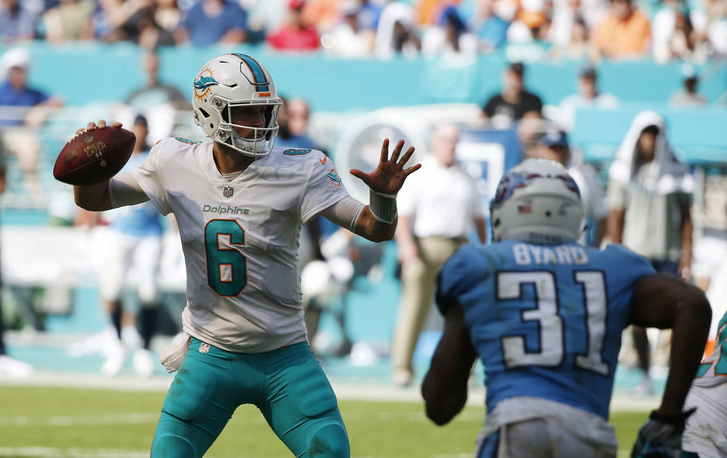 Miami Dolphins quarterback Jay Cutler (6) looks to pass under pressure from Tennessee Titans free safety Kevin Byard (31), during the second half of an NFL football game, Sunday, Oct. 8, 2017, in  ...