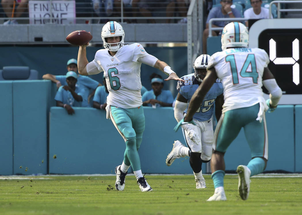 Miami Dolphins quarterback Jay Cutler (6) aims a pass to wide receiver Jarvis Landry (14), during the second half of an NFL football game against the Tennessee Titans, Sunday, Oct. 8, 2017, in Mia ...