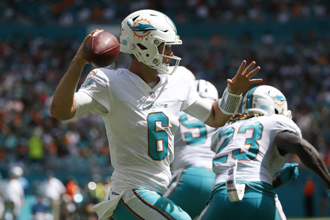 Miami Dolphins quarterback Jay Cutler (6) looks to pass the ball, during the first half of an NFL football game against the Tennessee Titans, Sunday, Oct. 8, 2017, in Miami Gardens, Fla. (AP Photo ...
