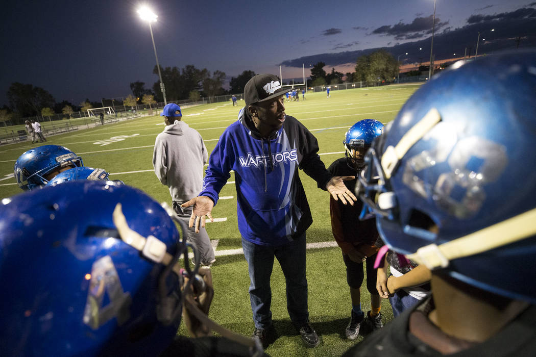 Warriors football coach Milton Burns talks to his players during the team's practice at a football field at Ed Fountain Park, Thursday, Nov. 2, 2017. Richard Brian Las Vegas Review-Journal @vegasp ...