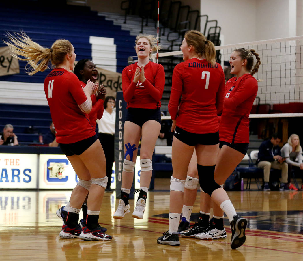 Coronado teammates celebrate after scoring a point against Foothill during the Class 4A Sunrise Region volleyball semifinal at Coronado High School in Henderson, Thursday, Nov. 2, 2017. Elizabeth  ...
