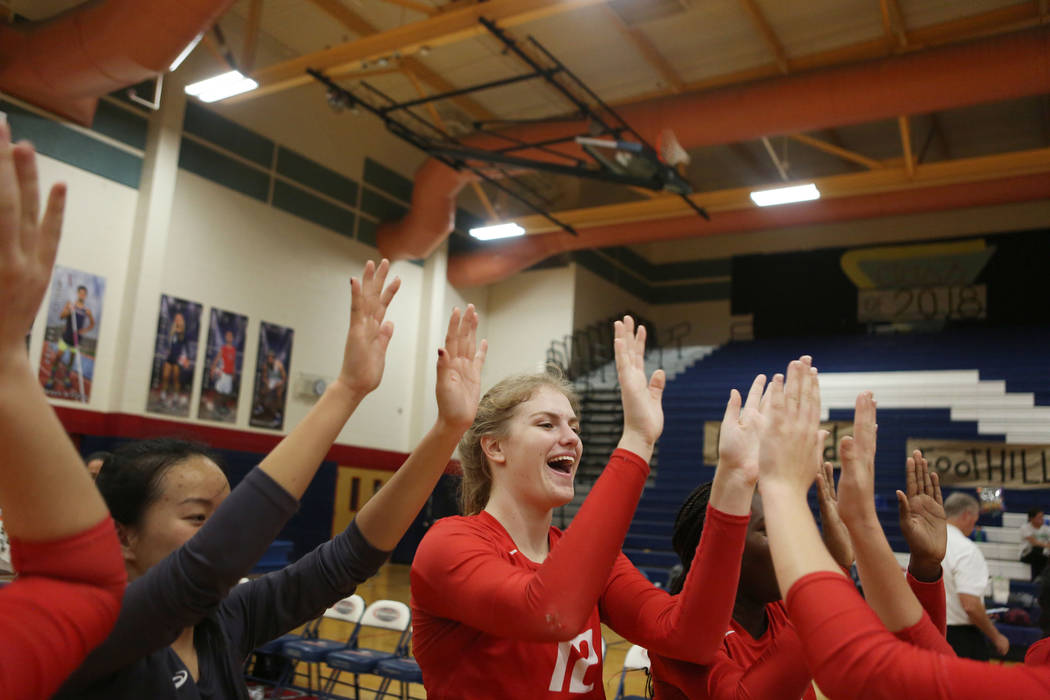 Coronado's Sasha Bolla, 12, celebrates with her teammates after beating Foothill during the Class 4A Sunrise Region volleyball semifinal at Coronado High School in Henderson, Thursday, Nov. 2, 201 ...