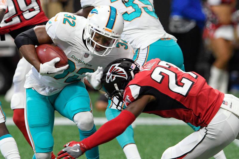 Oct 15, 2017; Atlanta, GA, USA; Miami Dolphins running back Kenyan Drake (32) is hit by Atlanta Falcons free safety Damontae Kazee (27) during the first quarter at Mercedes-Benz Stadium. Mandatory ...