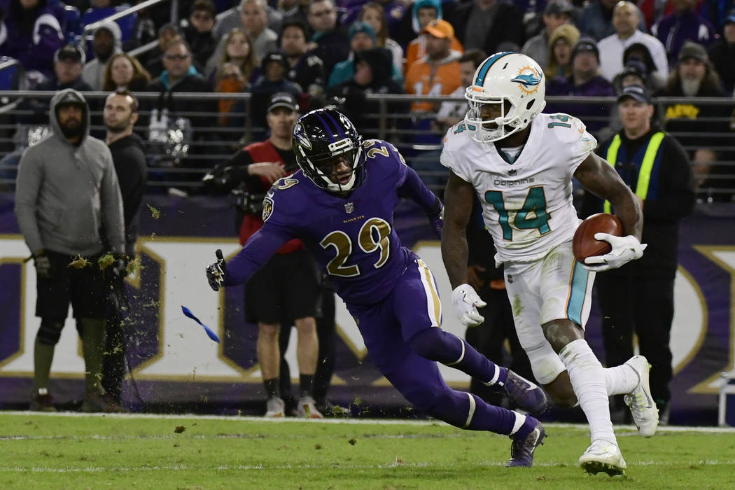 Oct 26, 2017; Baltimore, MD, USA;  Miami Dolphins wide receiver Jarvis Landry (14) runs as Baltimore Ravens cornerback Marlon Humphrey (29) defends during the third quarter at M&T Bank Stadium ...
