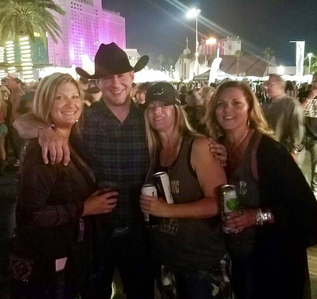 Adrian Murfitt, second from left, poses with fellow Route 91 Harvest festival goers. Murfitt is among the 59 people killed by the gunman who rained bullets onto Route 91 Harvest festival country m ...