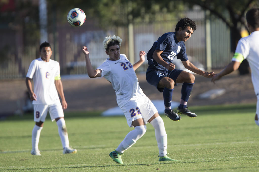 Durango's Cristian De Leon Morales (22) fights for ball procession against Legacy's Jose Miranda (23) in the playoff soccer game at the Bettye Wilson Soccer Complex in Las Vegas, Thursday, Nov. 2, ...