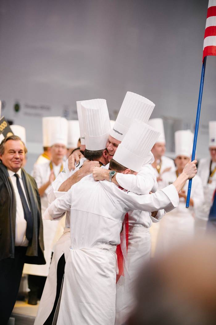 Team USA led by chef Mathew Peters, embrace after they won the Bocuse d'Or biennial competition in Lyon, France, in January. (David Escalante)