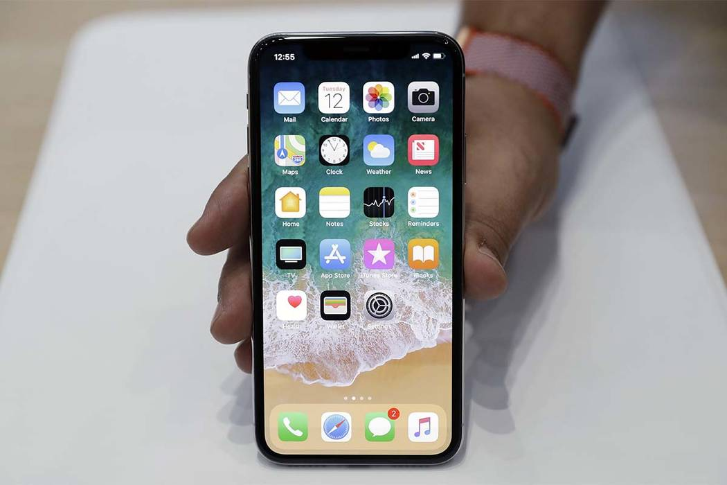 The new iPhone X is displayed in the showroom after the new product announcement at the Steve Jobs Theater on the new Apple campus in Cupertino, Calif. (AP Photo/Marcio Jose Sanchez, File)