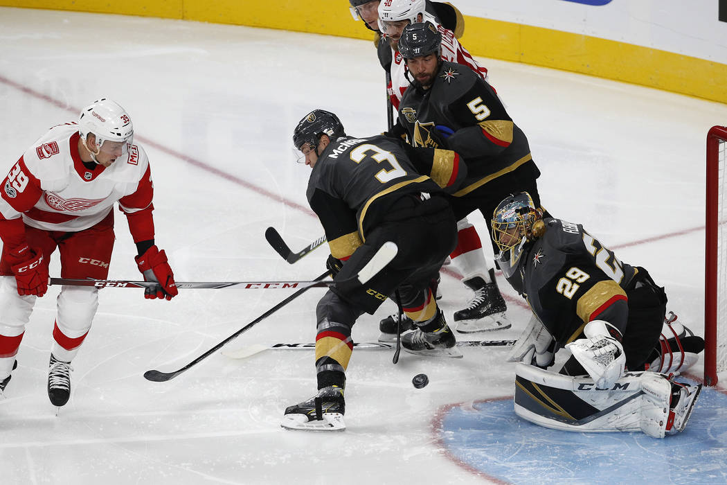 Vegas Golden Knights goalie Marc-Andre Fleury blocks a shot by Detroit Red Wings right wing Anthony Mantha, left, during the third period of an NHL hockey game Friday, Oct. 13, 2017, in Las Vegas. ...