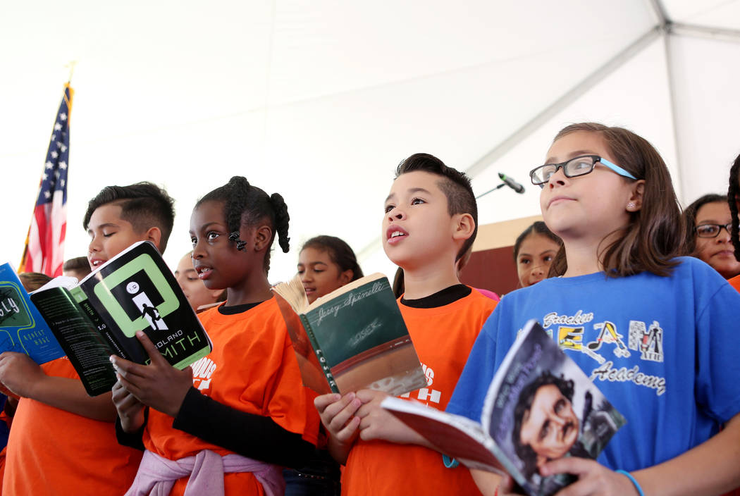 Students from Walter Bracken Elementary sing a song regarding learning from books during the Las Vegas-Clark County Library District groundbreaking of the new East Las Vegas Library branch in Las  ...