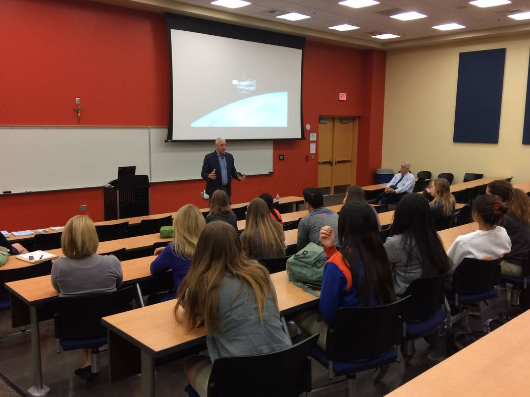 Mike Massimino, former NASA astronaut, talks to Bishop Gorman STEM students Oct. 18, 2017, about his two trips into space where he and his team worked on the Hubble space telescope. He said it's v ...