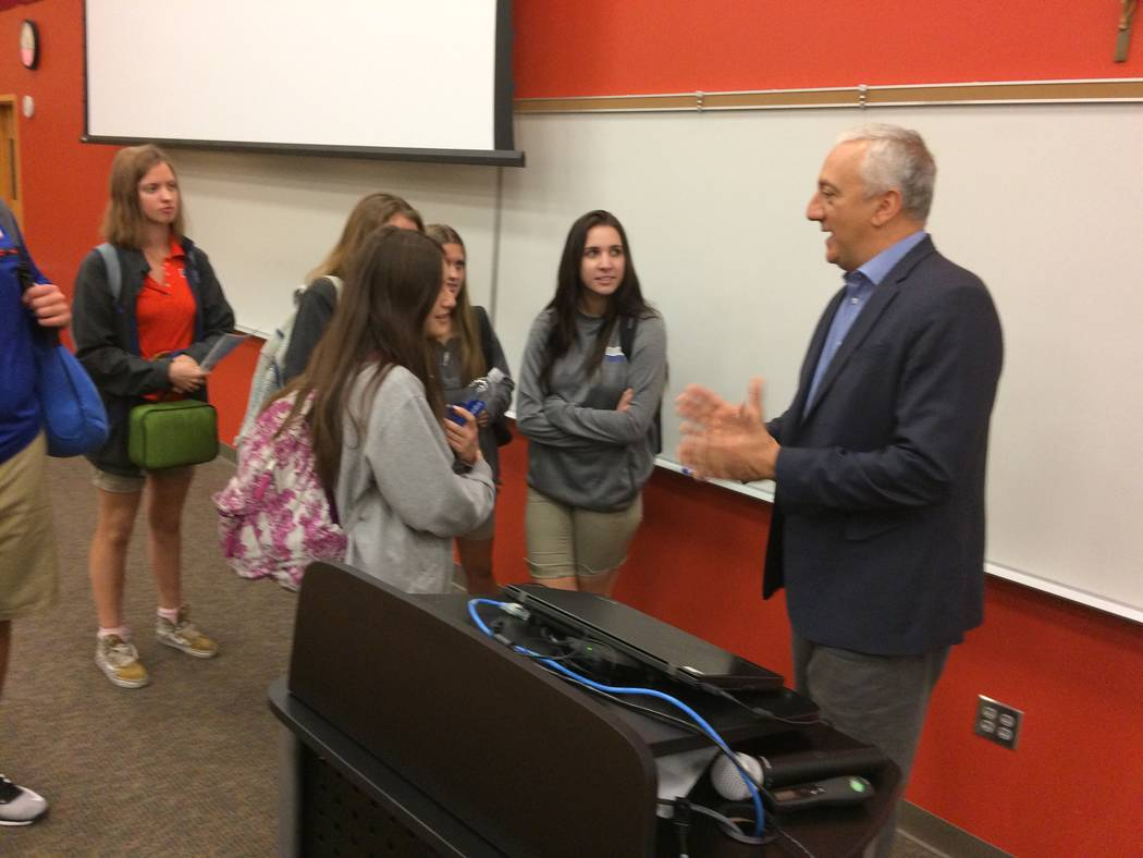 Mike Massimino, former NASA astronaut, talks to Bishop Gorman STEM students Oct. 18, 2017, about his two trips into space where he and his team worked on the Hubble space telescope. He gets to spe ...