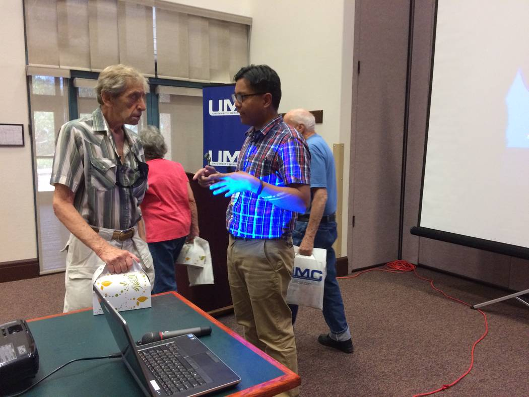 Dr. Arthur Romero, pulmonologist with UMC, answers questions on Sept. 19, 2017, with Sun City Summerlin residents about lung cancer and their risk. He was the guest speaker at one of the community ...