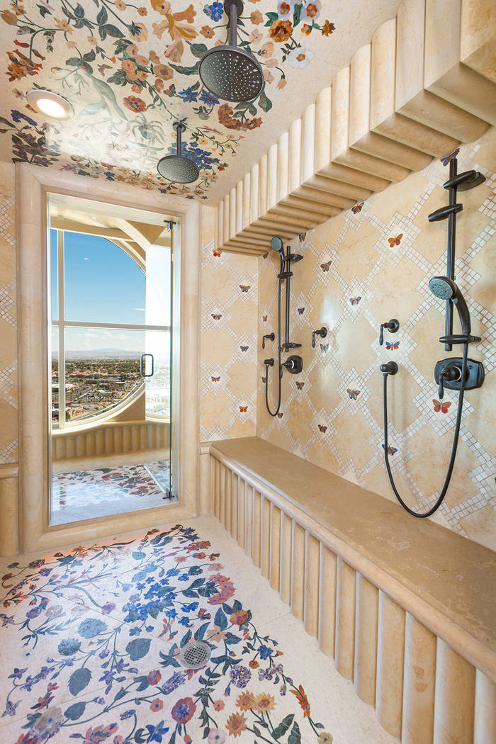 Butterflies appear in several tile designs throughout the home. These are in the master shower. (Luxury Estates International)
