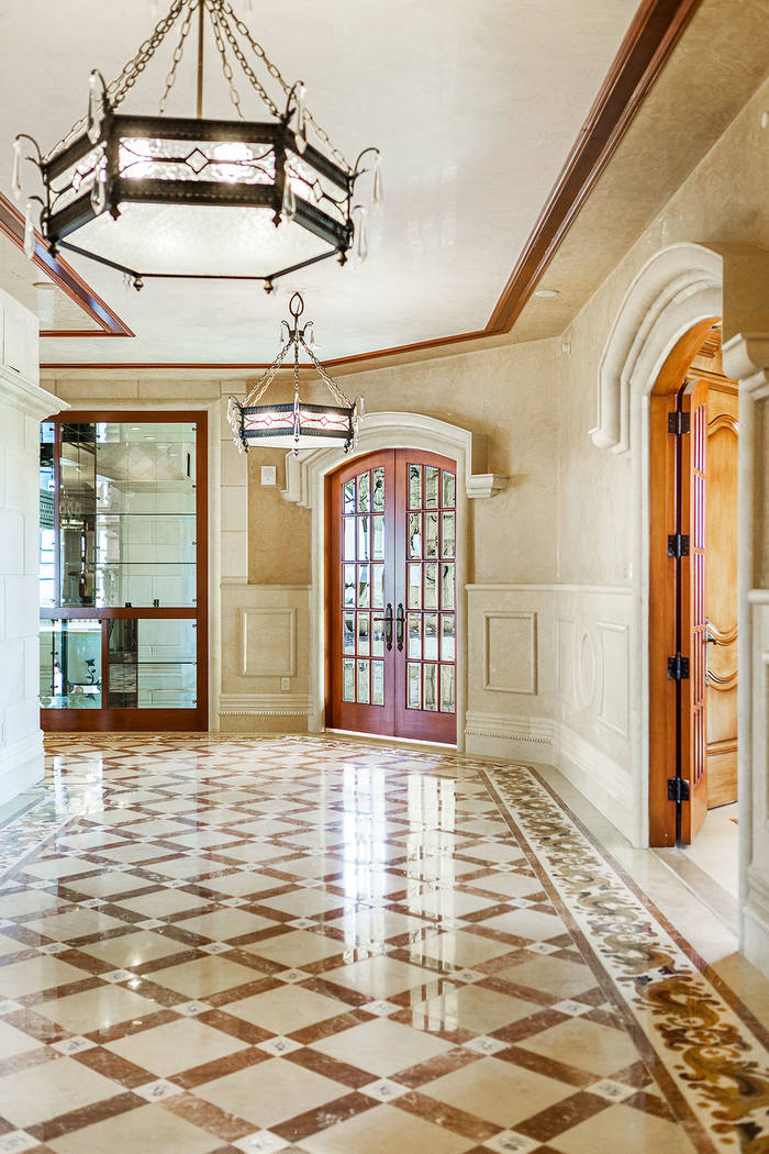 Venetian plaster (a very labor-intensive technique) is used extensively on the walls. (Luxury Estates International)