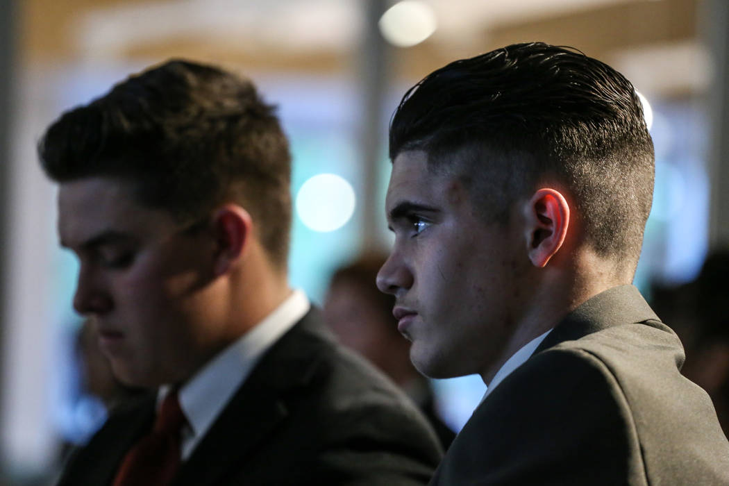 Basic High School students Danny Vella, 17, left, and CJ Dornak, 17, right, listen to presentations during the CTA Future Innovators Business Pitch Competition at the RedFlint Experience Center in ...