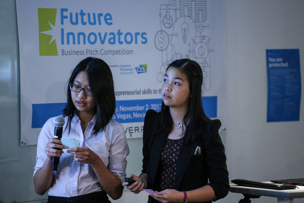Southwest Career and Technical Academy students Fiorina Chau, 15, left, and Amber To, 15, right, present during the CTA Future Innovators Business Pitch Competition at the RedFlint Experience Cent ...