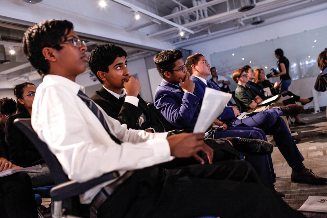 Southwest Career and Technical Academy students Ishaan Raja, 15, left, and Anish Ghejerla, 15, second from left, listen to presentations during the CTA Future Innovators Business Pitch Competition ...