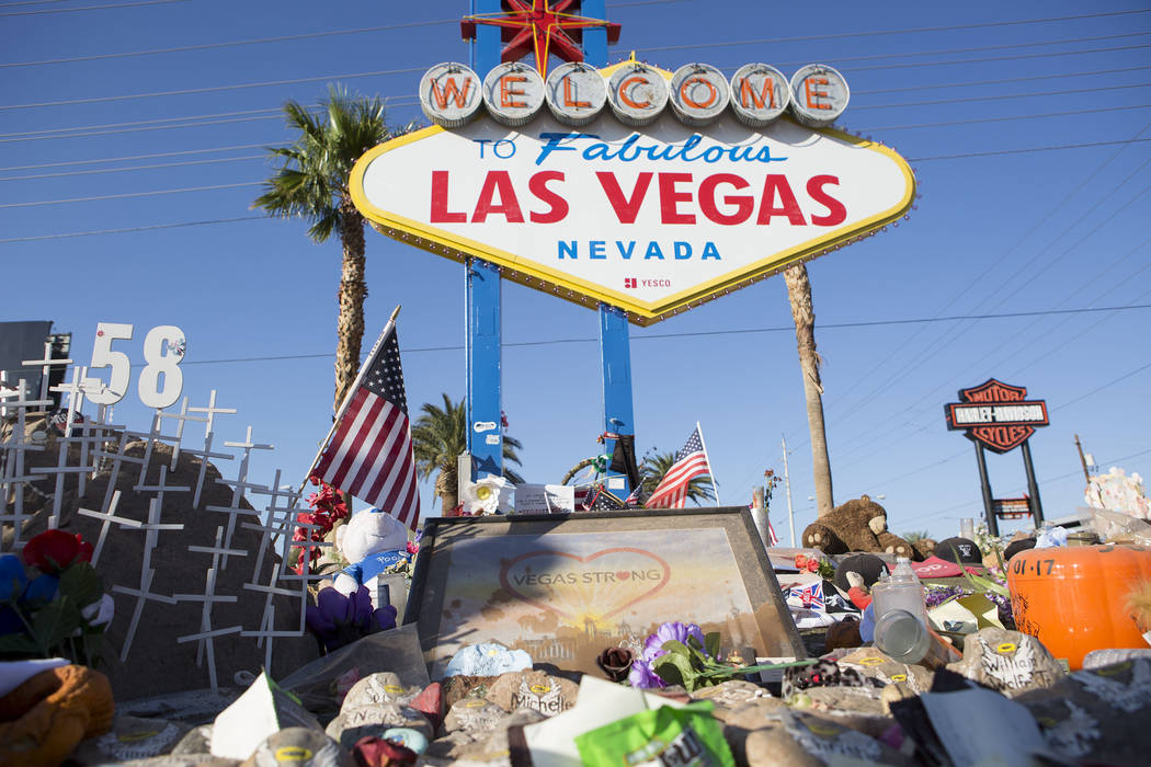 "People leave candles, notes, flowers and other small mementos at a makeshift memorial at the ""Welcome to Fabulous Las Vegas"" sign in Las Vegas on Tuesday, Oct. 31, 2017. (Bridget Bennett/Las Vegas ..."