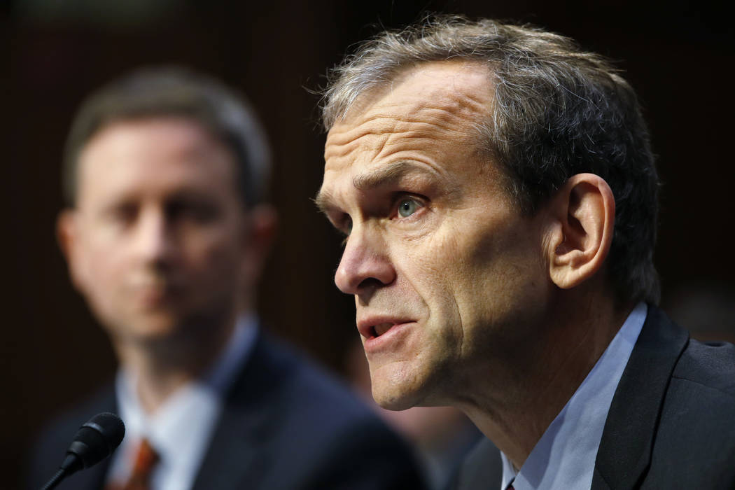 Google's Senior Vice President and General Counsel Kent Walker, right, speaks during a Senate Intelligence Committee hearing on Russian election activity and technology, Wednesday, Nov. 1, 2017, o ...