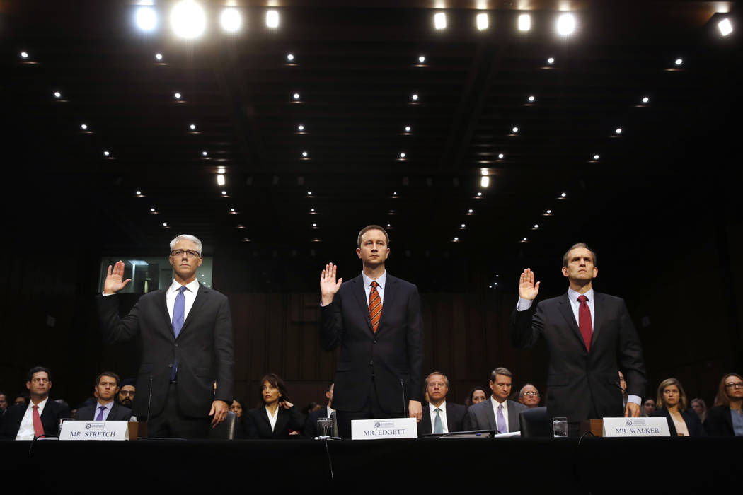 From left, Facebook's General Counsel Colin Stretch, Twitter's Acting General Counsel Sean Edgett, and Google's Senior Vice President and General Counsel Kent Walker, are sworn in for a Senate Int ...