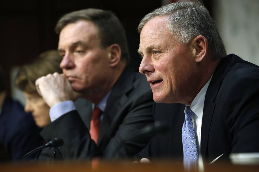 Senate Intelligence Committee chairman Sen. Richard Burr, R-N.C., right, speaks next to Vice Chairman Sen. Mark Warner, D-Va., during a Senate Intelligence Committee hearing on Russian election ac ...