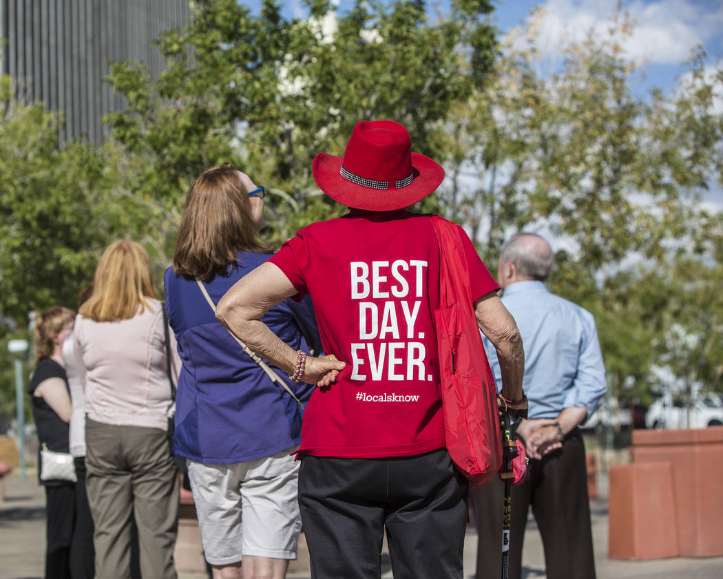 Babs Daitch, middle, listens to cultural urbanist Richard Hooker, of Las Vegas Urban Adventures, during a ten-block walking tour of downtown Las Vegas on Thursday, November 2, 2017. Benjamin Hager ...