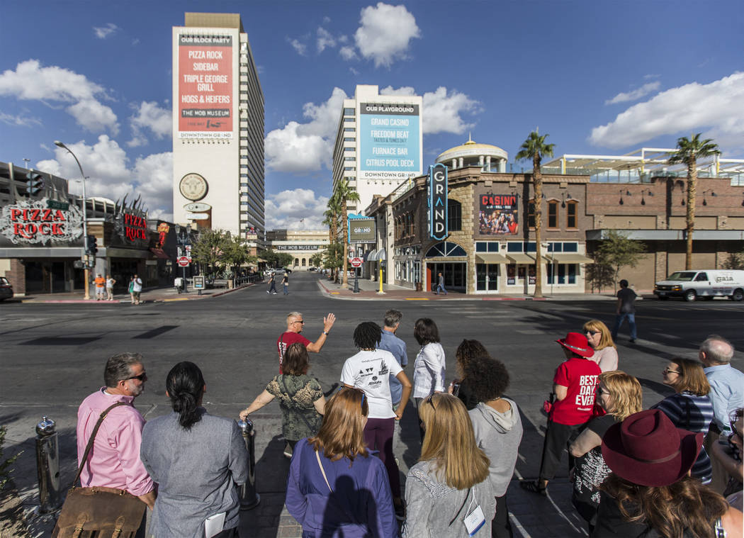 Cultural urbanist Richard Hooker, front/middle, of Las Vegas Urban Adventures, leads a ten-block walking tour of downtown Las Vegas on Thursday, November 2, 2017. Benjamin Hager Las Vegas Review-J ...