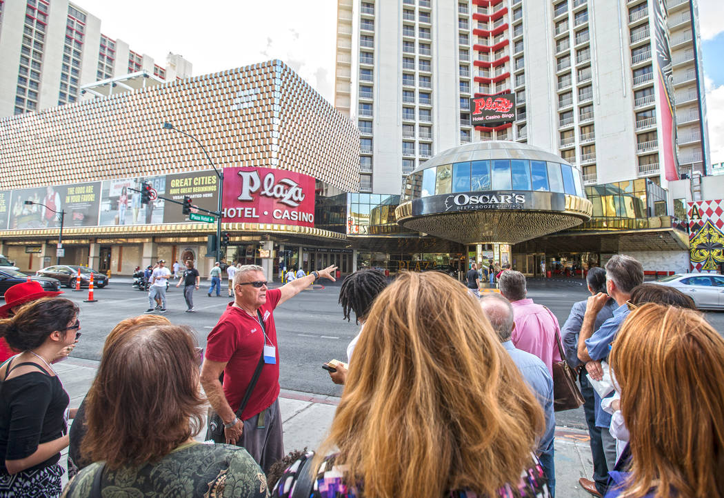 Cultural urbanist Richard Hooker, left, of Las Vegas Urban Adventures, points out historical features of The Plaza hotel-casino during a ten-block walking tour of downtown Las Vegas on Thursday, N ...