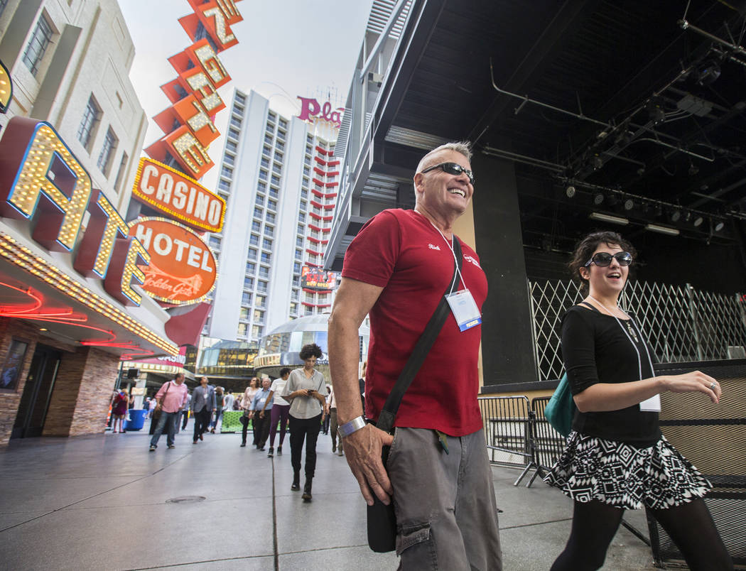Cultural urbanist Richard Hooker, left, of Las Vegas Urban Adventures, leads a ten-block walking tour of downtown Las Vegas though the Fremont Street Experience on Thursday, November 2, 2017. Benj ...