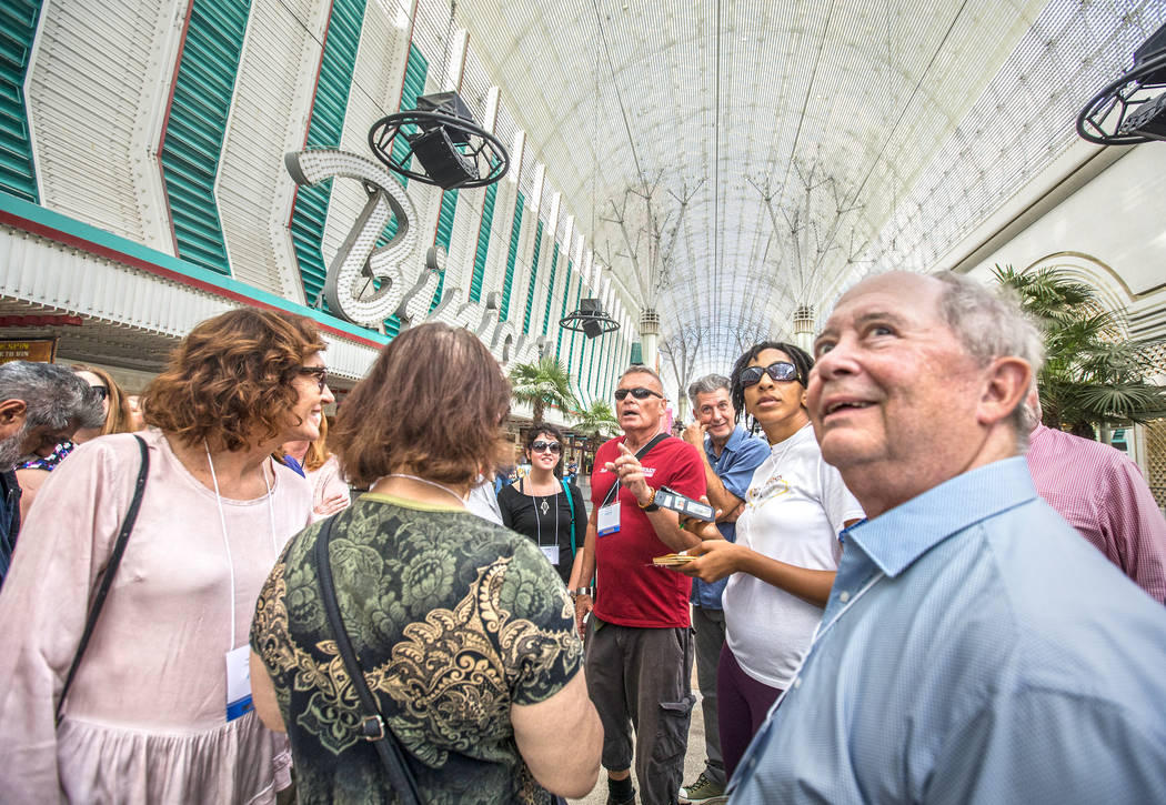 Cultural urbanist Richard Hooker, middle, of Las Vegas Urban Adventures, leads a ten-block walking tour of downtown Las Vegas though the Fremont Street Experience on Thursday, November 2, 2017. Be ...