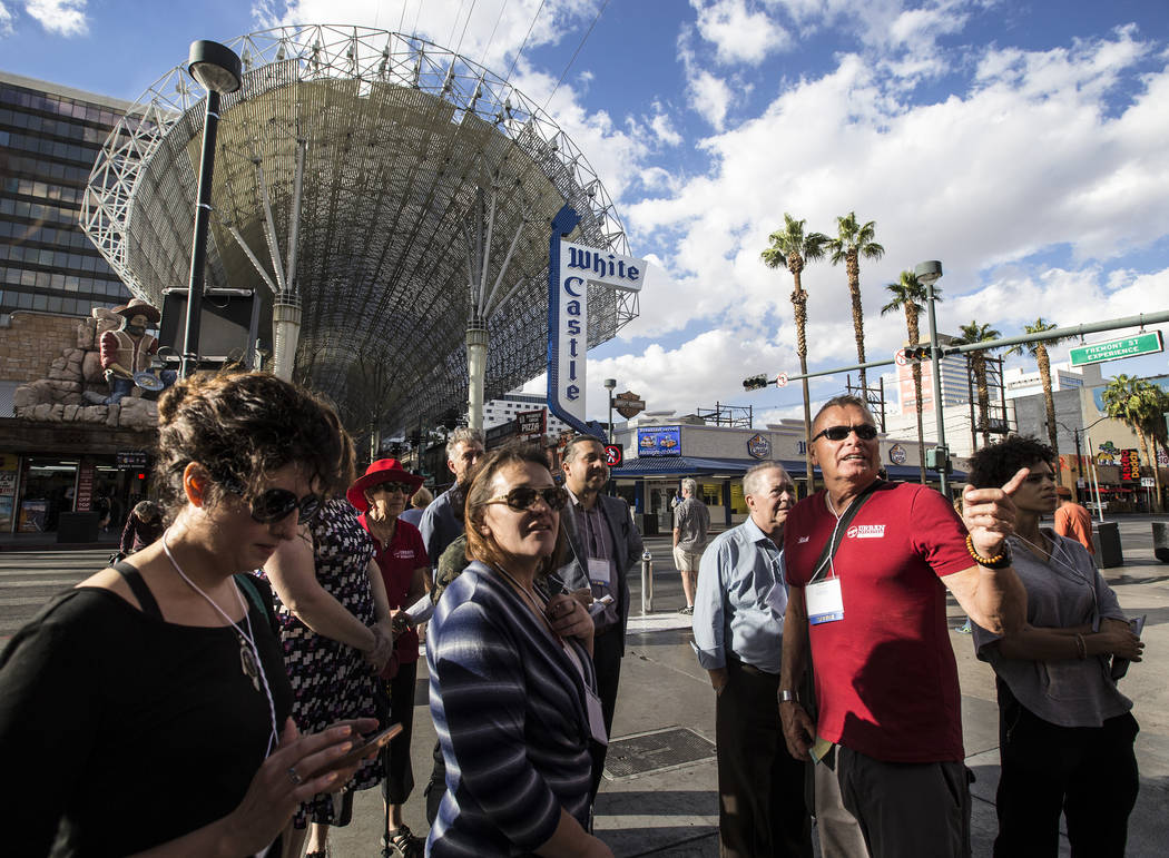 Cultural urbanist Richard Hooker, right, of Las Vegas Urban Adventures, leads a ten-block walking tour of downtown Las Vegas outside the Fremont Street Experience on Thursday, November 2, 2017. Be ...