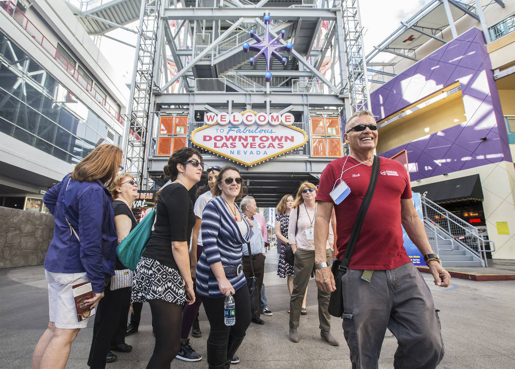 Cultural urbanist Richard Hooker, right, of Las Vegas Urban Adventures, leads a ten-block walking tour of downtown Las Vegas though the Fremont Street Experience on Thursday, November 2, 2017. Ben ...