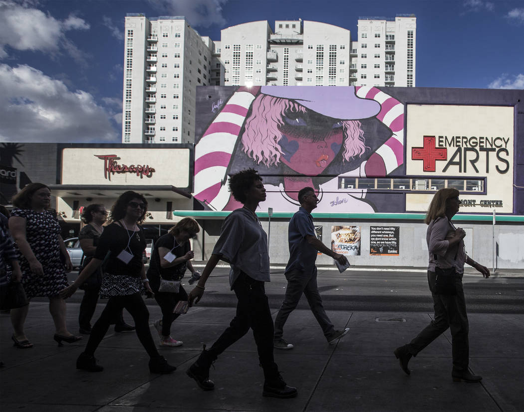 Downtown Las Vegas walking tour attendees walk down Fremont Street on Thursday, November 2, 2017, in Las Vegas. Benjamin Hager Las Vegas Review-Journal @benjaminhphoto
